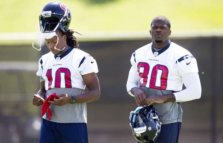 Wide receivers DeAndre Hopkins (10) and Andre Johnson (80) walk across the practice field.