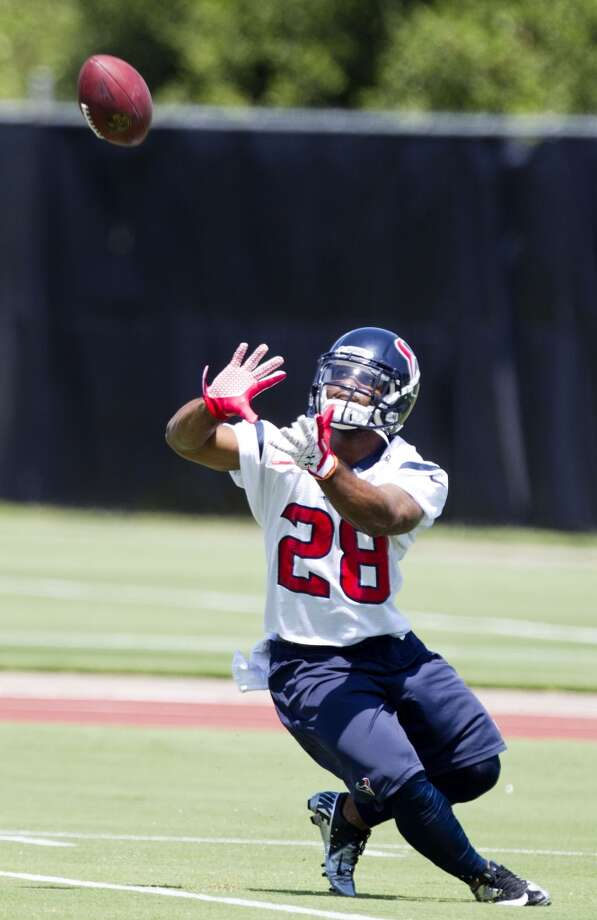 Texans running back Dennis Johnson catches a pass.