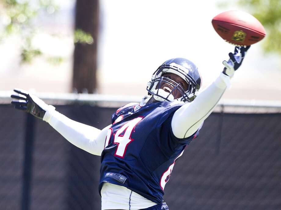 Texans defensive end Delano Johnson tips a pass.