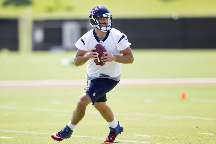 Texans quarterbacks Matt Schaub rolls out to pass.