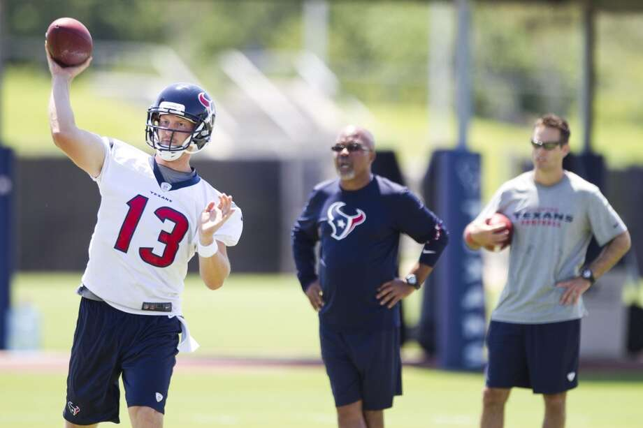 Texans quarterback T.J. Yates (13) throws a pass.