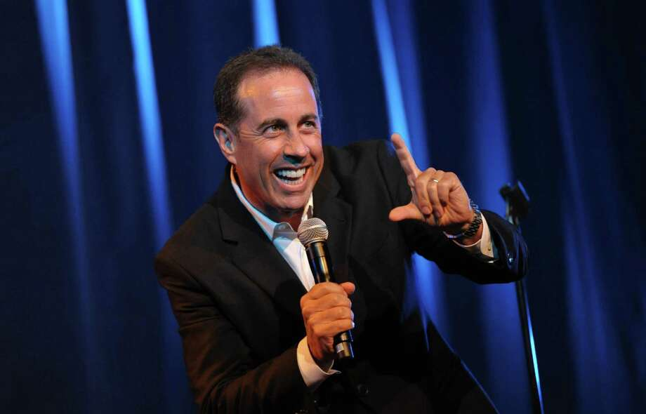 FILE - In this June 30, 2012 file photo released by the David Lynch Foundation, comedian Jerry Seinfeld performs onstage at the David Lynch Foundation: A Night of Comedy honoring George Shapiro in Beverly Hills, Calif. Seinfeld has added a show in Long Island to his new comedy tour and will donate all proceeds to it and two other performances to Superstorm Sandy relief. (Photo by John Shearer/Invision for David Lynch Foundation, File) Photo: John Shearer, ASSOCIATED PRESS / A20122012