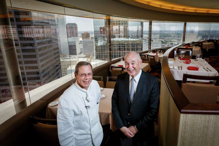 Executive Chef Frank Majowicz, left, and Joe Mannke pose for a photo inside the Spindletop Restaurant at the top of the Hyatt Regency, Tuesday, May 28, 2013, in Houston.  The Spindletop is turning 40 in June and to mark the anniversary the restaurant is creating dishes and cocktails that pay homage to the food and drink of the 70's when the restaurant first made the scene.  ( Michael Paulsen / Houston Chronicle ) Photo: Michael Paulsen, Staff / © 2013 Houston Chronicle