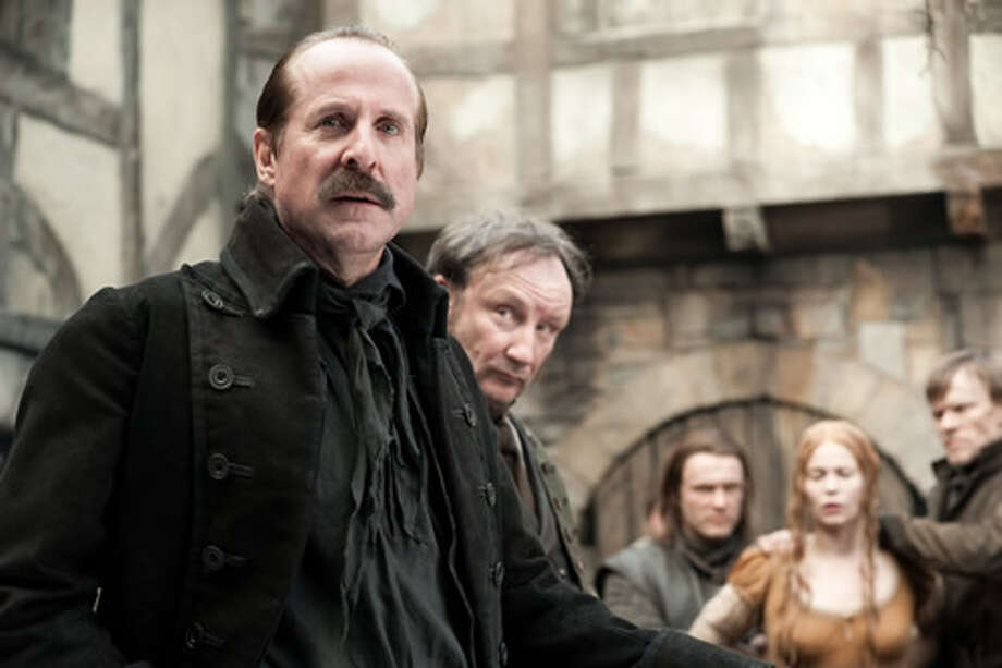 Peter Stormare as Sheriff Berringer and Pihla Viitala as Mina (background).