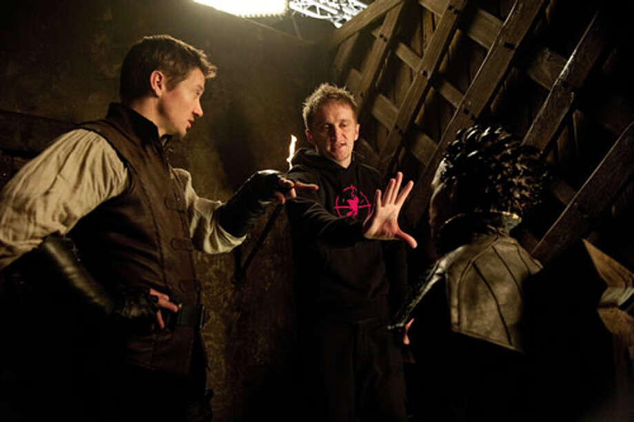 Jeremy Renner as Hansel with director Tommy Wirkola and Ingrid Bolsø Berdal as Horned Witch.