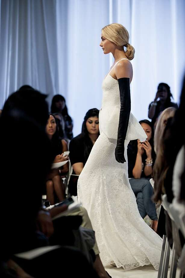 One of the 17 gowns from Vera Wang's 2014 spring bridal collection that were shown at the Unveiled: Bridal Style Revealed event at City View. Photo: ToAmaze Wedding Photography