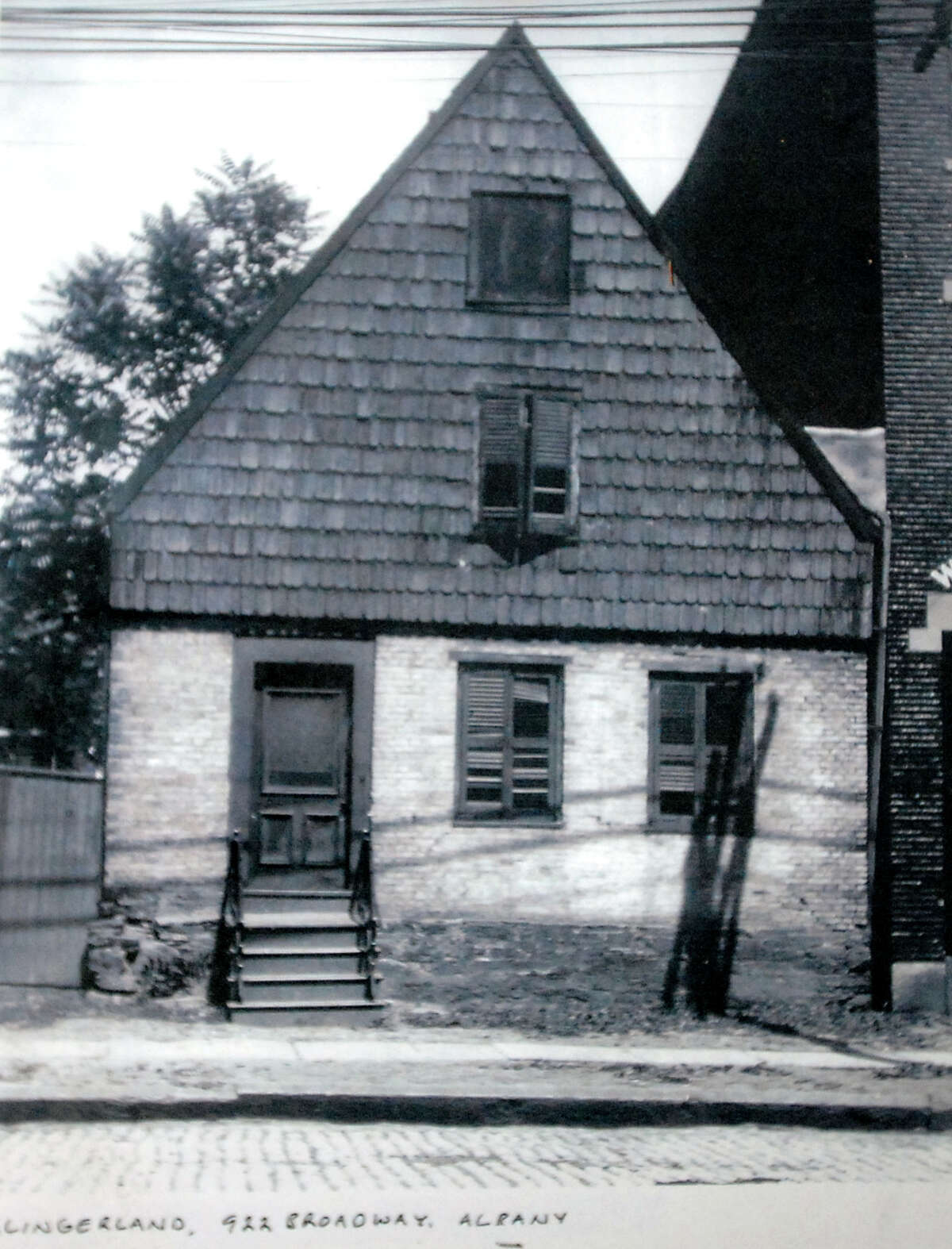 Copy of a photo on display inside 48 Hudson Ave. in 2008 in Albany, N.Y. The photo resembles the Van Ostrande-Radliff House, a Dutch-style home built around 1720 that is one of the oldest homes in the Capital Region. (Cindy Schultz / Times Union archive)