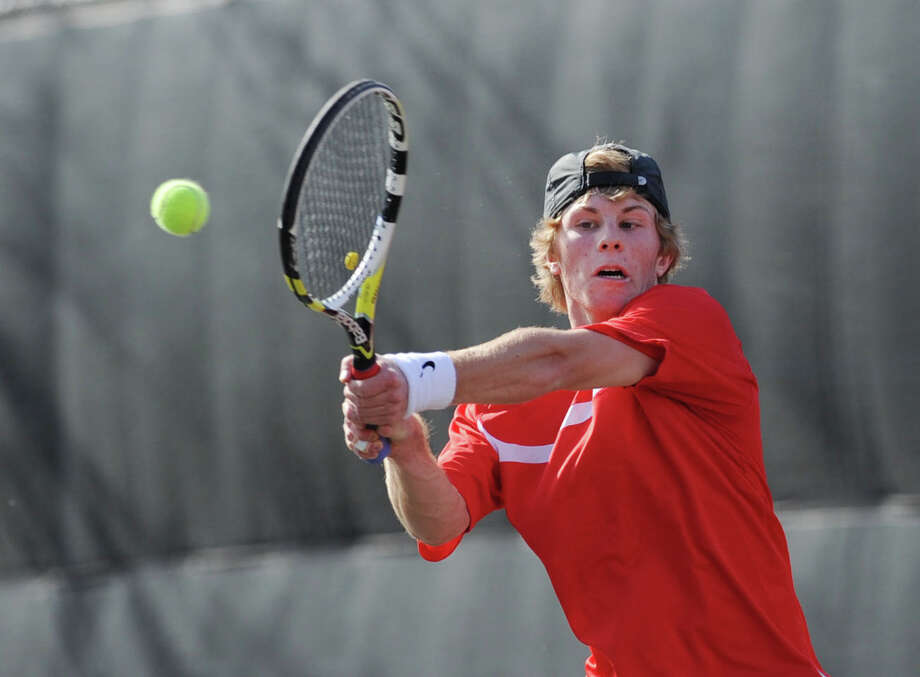 Blake Niehaus of Greenwich hits against Will Burger of New Canaan in the boys high school tennis match between Greenwich High School and New Canaan High School at Greenwich, Tuesday, April 9, 2013. Greenwich won the match, 7-0. Photo: Bob Luckey / Greenwich Time