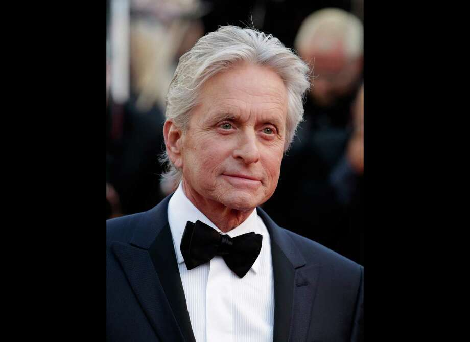 FILE - Actor Michael Douglas poses for photographers as he arrives for the screening of Behind the Candelabra at the 66th international film festival, in Cannes, southern France, in this May 21, 2013 file photo. The Guardian newspaper published an interview Monday, June 3, 2013, saying that Douglas attributed his throat cancer to the HPV virus from oral sex. A representative for Douglas now says the actor doesn't blame his throat cancer on oral sex. (AP Photo/David Azia, File) Photo: David Azia
