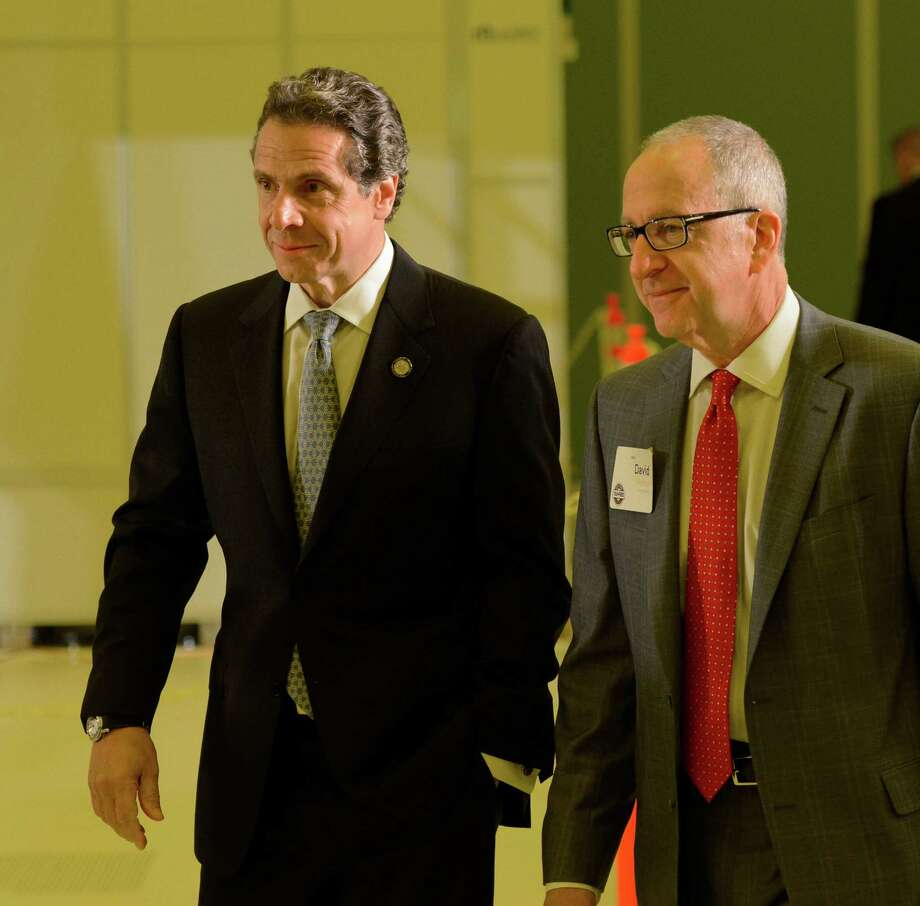 Governor Andrew Cuomo, left, is joined by Cornell president David Skorton as he continues his speaking engagements for his Tax-Free intitiative June 3, 2013, at the College of Nanoscale Science and Engineering in Albany, N.Y.     (Skip Dickstein/Times Union) Photo: Skip Dickstein / 00022671A