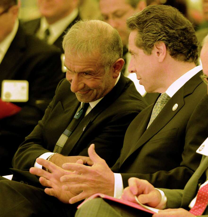 Governor Andrew Cuomo, right shares a laugh with Alain E. Kaloyeros senior vice president and chief executive officer, College of Nanoscale Science and Engineering at the College of Nanoscale Science and Engineering in Albany. ( Times Union archive ) Photo: Skip Dickstein / 00022671A