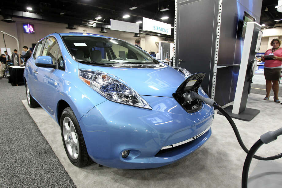 A Nissan Leaf is powered up at the Plug-In-2012 Convention & Expo at the Gonzalez Convention Center last July. Nissan Motor Co. beat expectations with a 25 percent increase in new cars and trucks sold in May compared with the same month last year. Photo: Tom Reel / San Antonio Express-News