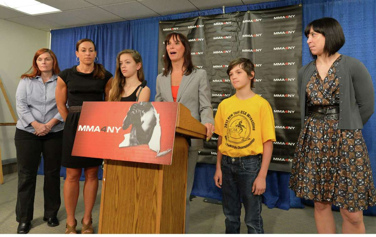Jeniifer Bonjean, center, legal commentator and MMA enthusiast, speaks during a press conference June 3, 2013, asking for the legalization of MMA by the state legislature in Albany, N.Y. Bonjean is joined by other advocates of the passage of the bill. (Skip Dickstien/Times Union)