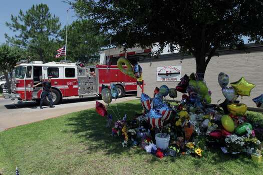 A makeshift memorial grows outside Fire Station 51, where two of the fallen firefighters were stationed. Photo: James Nielsen, Staff / © 2013  Houston Chronicle