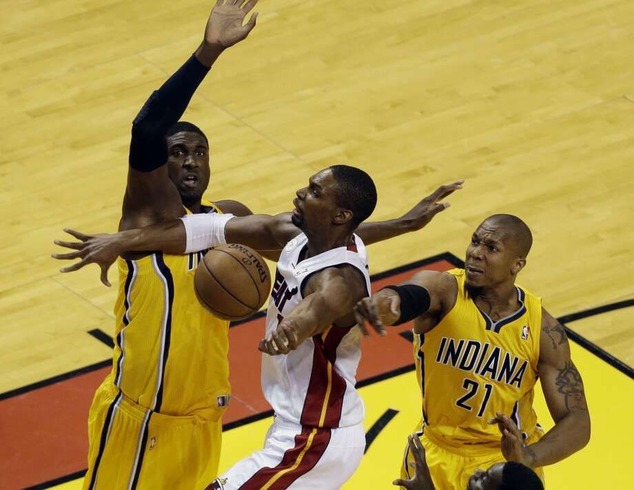 Indiana Pacers center Roy Hibbert (55) and forward David West (21) blocks a drive to the basket by Miami Heat center Chris Bosh (1) during the first half of Game 7 in their NBA basketball Eastern Conference finals playoff series, Monday, June 3, 2013 in Miami. (AP Photo/Wilfredo Lee)