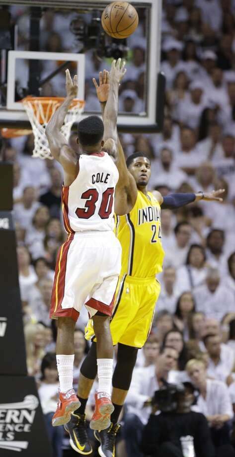 Miami Heat point guard Norris Cole (30) drives to the basket over Indiana Pacers small forward Paul George (24) during the first half of Game 7 in their NBA basketball Eastern Conference finals playoff series, Monday, June 3, 2013 in Miami. (AP Photo/Lynne Sladky)