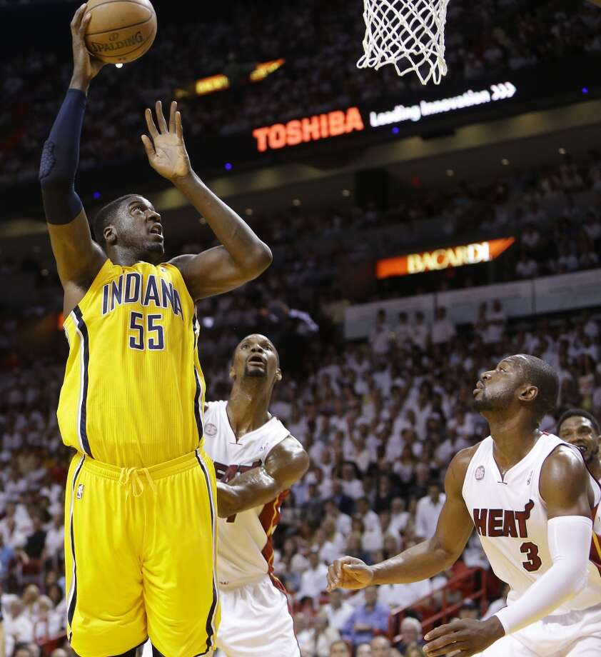 Miami Heat center Chris Bosh (1) land Miami Heat shooting guard Dwyane Wade (3) look on as Indiana Pacers center Roy Hibbert (55 ) shoots during the first half of Game 7 in their NBA basketball Eastern Conference finals playoff series, Monday, June 3, 2013 in Miami. (AP Photo/Lynne Sladky)