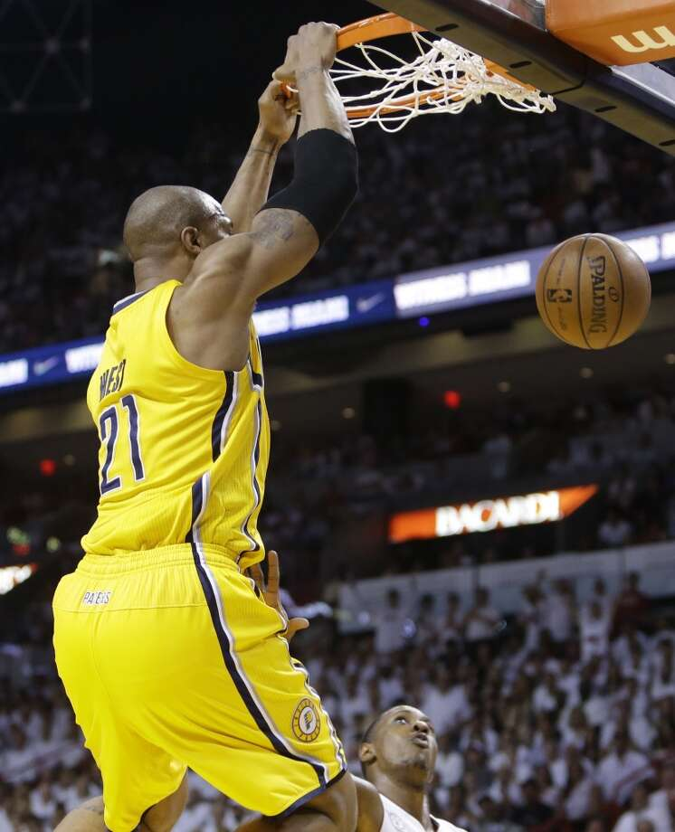 Indiana Pacers power forward David West (21) dunks the ball over Miami Heat point guard Mario Chalmers (15) during the first half of Game 7 in their NBA basketball Eastern Conference finals playoff series, Monday, June 3, 2013 in Miami. (AP Photo/Lynne Sladky)