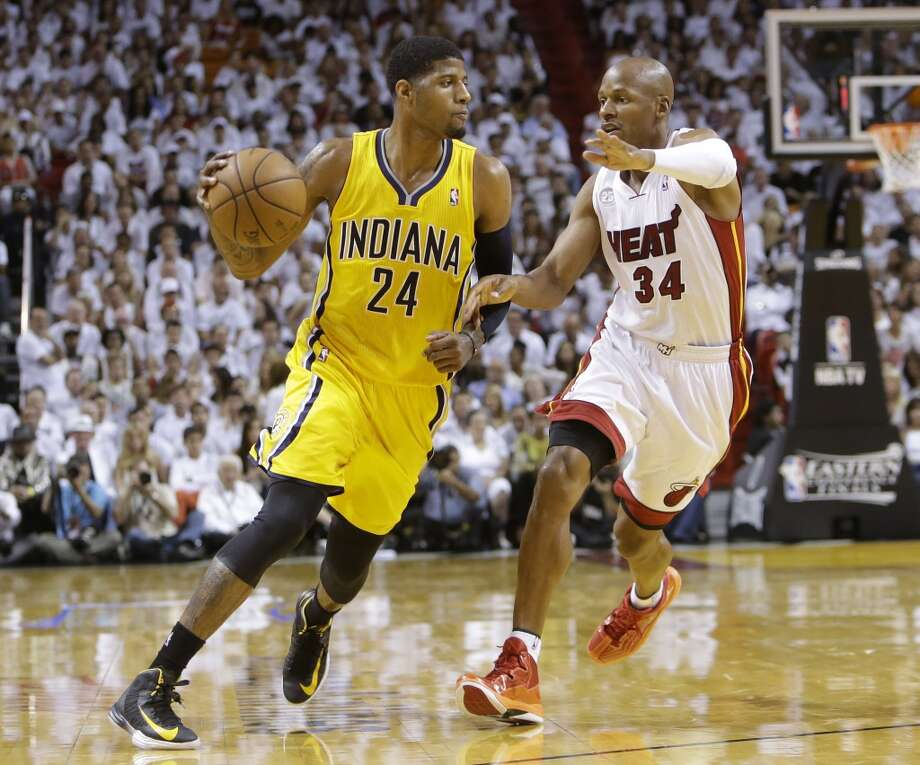 Indiana Pacers  forward Paul George (24) dribbles the ball as Miami Heat  guard Ray Allen (34) during the first half of Game 7 in their NBA basketball Eastern Conference finals playoff series, Monday, June 3, 2013 in Miami. (AP Photo/Lynne Sladky)