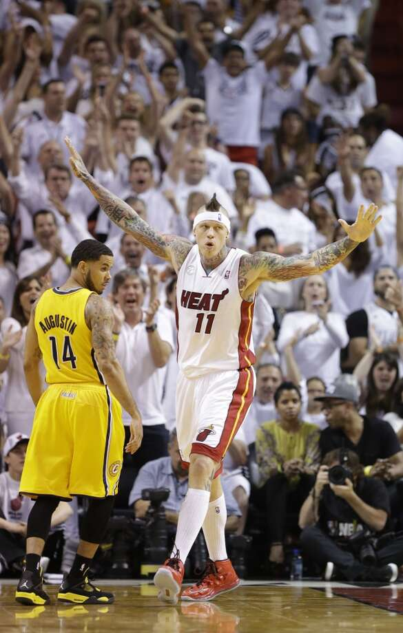 Miami Heat power forward Chris Andersen (11) gestures after a basket as Indiana Pacers point guard D.J. Augustin (14) walks away during the first half of Game 7 in their NBA basketball Eastern Conference finals playoff series, Monday, June 3, 2013 in Miami. (AP Photo/Lynne Sladky)