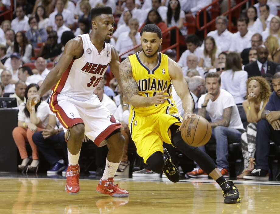 Indiana Pacers  guard D.J. Augustin (14) dribbles the ball as Miami Heat guard Norris Cole (30)defends during the first half of Game 7 in their NBA basketball Eastern Conference finals playoff series, Monday, June 3, 2013 in Miami. (AP Photo/Lynne Sladky)