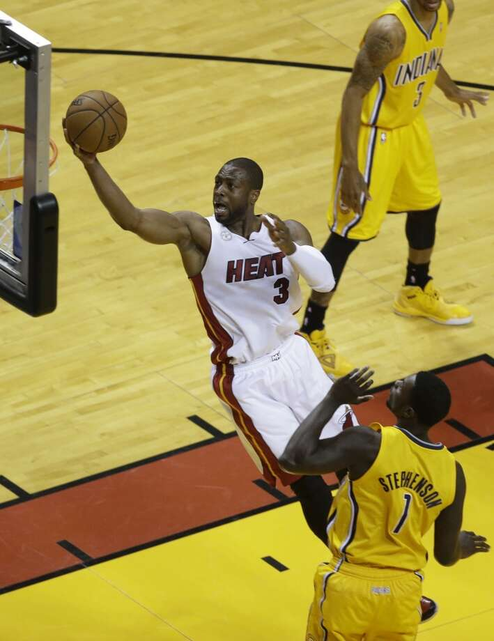 Miami Heat shooting guard Dwyane Wade (3) drives to the basket over Indiana Pacers shooting guard Lance Stephenson (1) during the first half of Game 7 in their NBA basketball Eastern Conference finals playoff series, Monday, June 3, 2013 in Miami. (AP Photo/Wilfredo Lee)