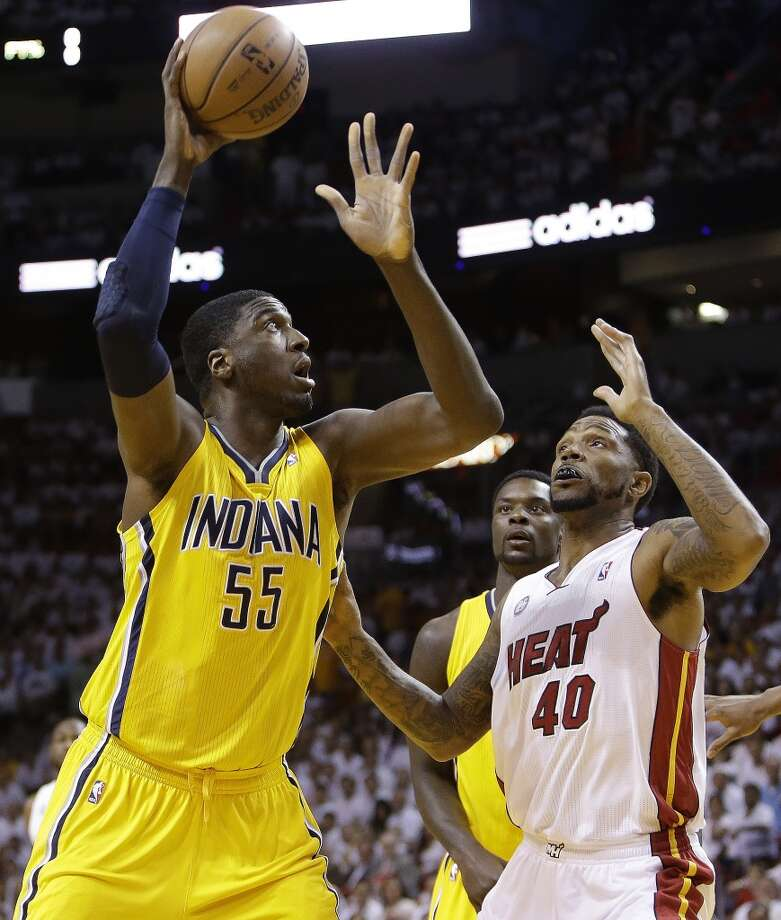 Indiana Pacers center Roy Hibbert (55) shoots under the defense of Miami Heat power forward Udonis Haslem (40) during the first half of Game 7 in their NBA basketball Eastern Conference finals playoff series, Monday, June 3, 2013 in Miami. (AP Photo/Lynne Sladky)