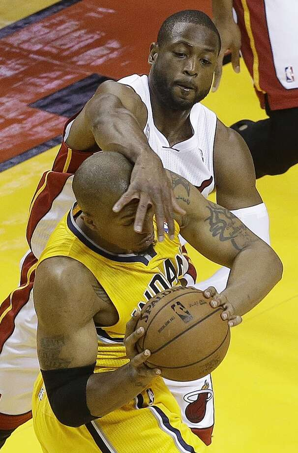 Indiana Pacers power forward David West (21) and Miami Heat shooting guard Dwyane Wade (3) vie for the ball during the first half of Game 7 in their NBA basketball Eastern Conference finals playoff series, Monday, June 3, 2013 in Miami. (AP Photo/Wilfredo Lee)
