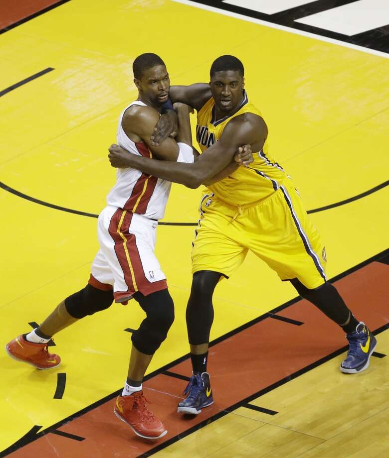 Miami Heat center Chris Bosh (1) and Indiana Pacers center Roy Hibbert (55) during the first half of Game 7 in their NBA basketball Eastern Conference finals playoff series, Monday, June 3, 2013 in Miami. (AP Photo/Wilfredo Lee)