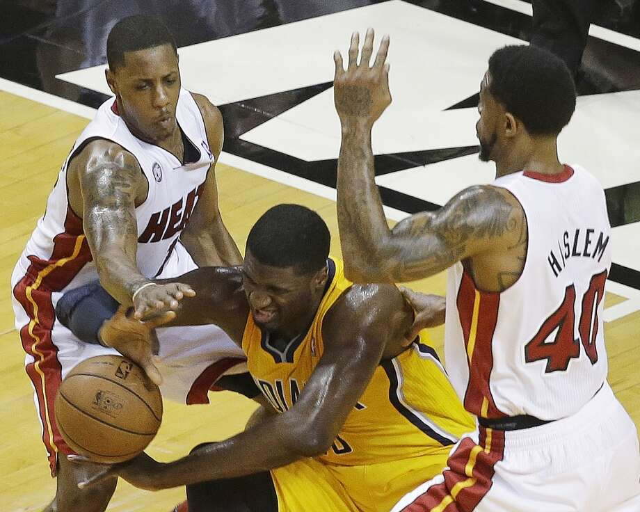 Miami Heat power forward Udonis Haslem (40) Miami Heat point guard Mario Chalmers (15) Indiana Pacers center Roy Hibbert (55) vie for the ball during the first half of Game 7 in their NBA basketball Eastern Conference finals playoff series, Monday, June 3, 2013 in Miami. (AP Photo/Wilfredo Lee)