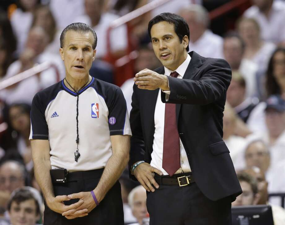Miami Heat head coach Erik Spoelstra gestures to official Ken Mauer during the first half of Game 7 in their NBA basketball Eastern Conference finals playoff series against the Indiana Pacers, Monday, June 3, 2013 in Miami. (AP Photo/Lynne Sladky)