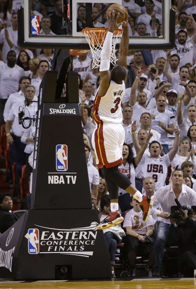 Miami Heat shooting guard Dwyane Wade (3) dunks the ball during the first half of Game 7 in their NBA basketball Eastern Conference finals playoff series against the Indiana Pacers, Monday, June 3, 2013 in Miami. (AP Photo/Lynne Sladky)