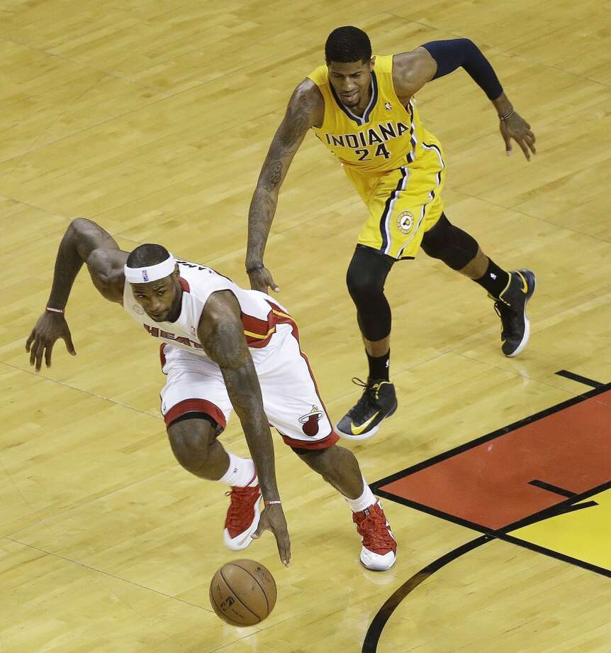 Miami Heat small forward LeBron James (6) steals the ball from Indiana Pacers small forward Paul George (24) during the first half of Game 7 in their NBA basketball Eastern Conference finals playoff series, Monday, June 3, 2013 in Miami. (AP Photo/Wilfredo Lee)