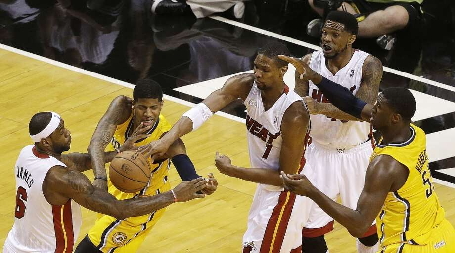 Miami Heat center Chris Bosh (1) Miami Heat small forward LeBron James (6) gain control of the ball as Indiana Pacers small forward Paul George (24) loses it during the first half of Game 7 in their NBA basketball Eastern Conference finals playoff series, Monday, June 3, 2013 in Miami. (AP Photo/Wilfredo Lee)