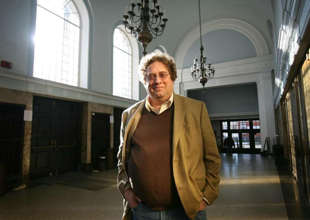 Miles Marek, producing director of the Klein in Bridgeport, in the building's dramatic outer lobby.