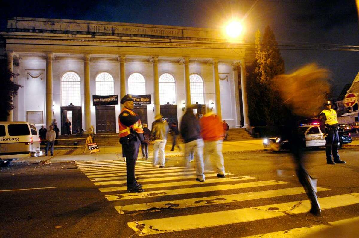 Concert goers cross the street to enter the Knlein Auditorium to see Dark Star Orchestra in Bridgeport, Conn. on Thursday Nov. 19, 2009.