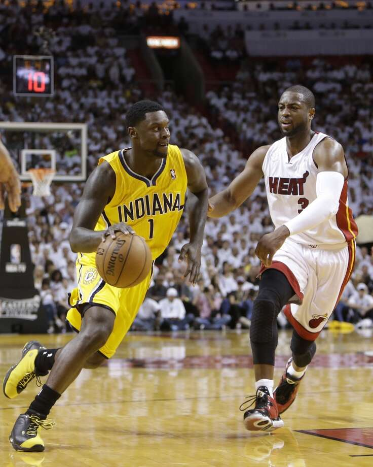 Indiana Pacers  guard Lance Stephenson (1) dribbles the ball as Miami Heat shooting guard Dwyane Wade (3) defends  during the first half of Game 7 in their NBA basketball Eastern Conference finals playoff series, Monday, June 3, 2013 in Miami. (AP Photo/Lynne Sladky)