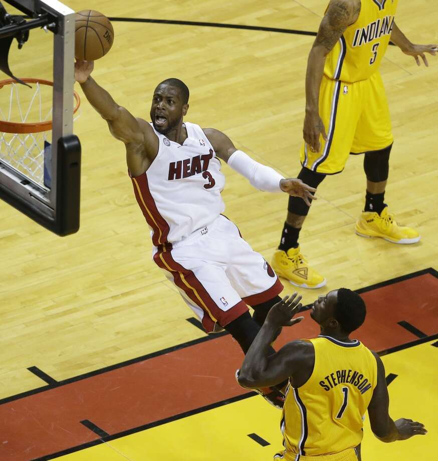 Miami Heat shooting guard Dwyane Wade (3) heads to the basket as Indiana Pacers shooting guard Lance Stephenson (1) looks on during the first half of Game 7 in their NBA basketball Eastern Conference finals playoff series, Monday, June 3, 2013 in Miami. (AP Photo/Wilfredo Lee)