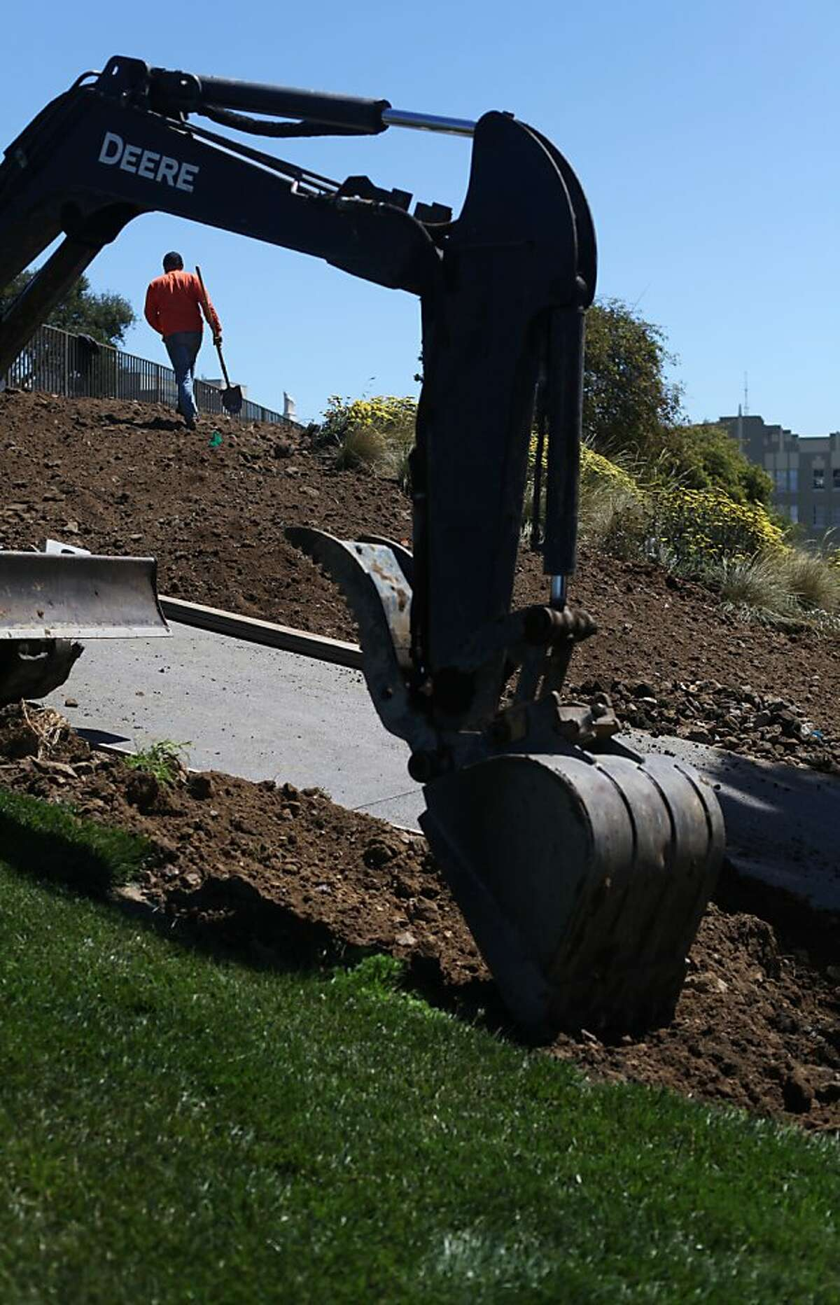 Francisco Magana walks up a hill on the south side of Lafayette Park on May 30, 2013 in San Francisco, Calif. Magana was grading soil in preparation for planting more flowers. Lafayette Park is slated to reopen June 8, 2013.
