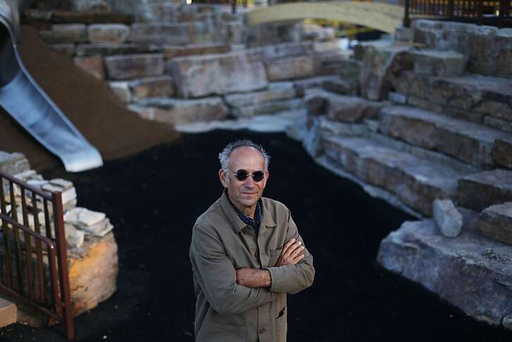 Jeffrey Miller poses for a portrait on the playground he designed in Lafayette Park on June 1, 2013 in San Francisco, Calif. Miller chose the stones for the playground, seen behind him, on three trips to Montana. Lafayette Park is slated to reopen June 8, 2013.