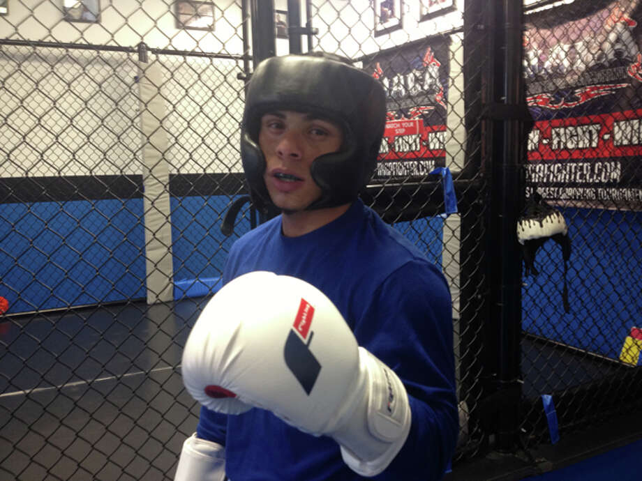 Local boxer Omar Bordoy trains at the Connecticut Academy of Kickboxing on White Street in Danbury.