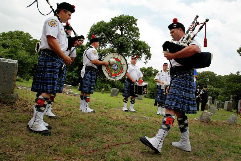 "Zane Krempin, far right in foreground, and other Dallas Firefighter Pipes & Drums members perform ""Amazing Grace"" in Dallas. Photo: Kye R. Lee, The Dallas Morning News / 00017664A"