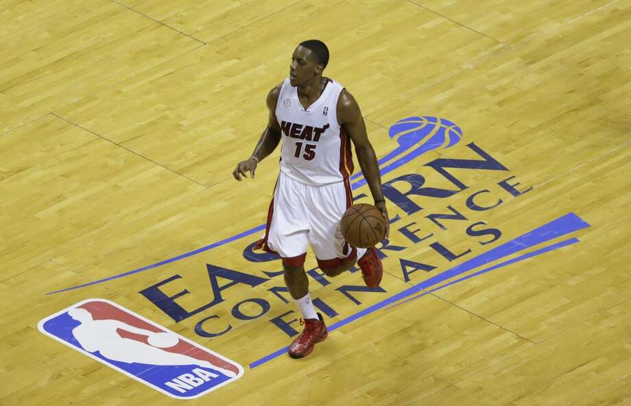 Miami Heat point guard Mario Chalmers (15) dribbles the ball during the first half of Game 7 in their NBA basketball Eastern Conference finals playoff series against the Indiana Pacers, Monday, June 3, 2013 in Miami. (AP Photo/Wilfredo Lee)