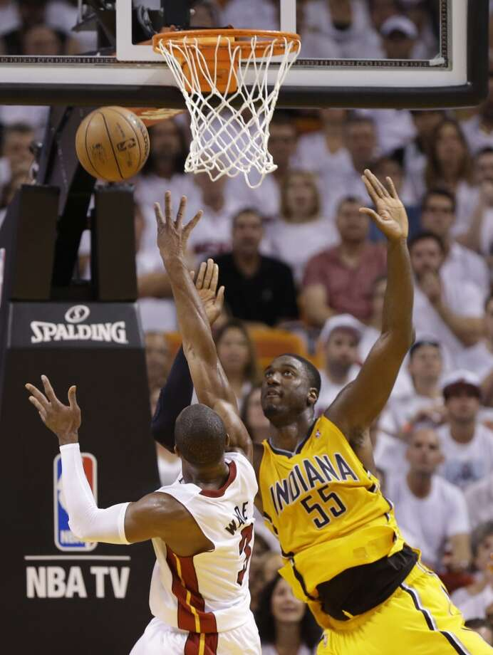 Miami Heat shooting guard Dwyane Wade (3) drives to the basket as Indiana Pacers center Roy Hibbert (55) defends during the first half of Game 7 in their NBA basketball Eastern Conference finals playoff series, Monday, June 3, 2013 in Miami. (AP Photo/Lynne Sladky)