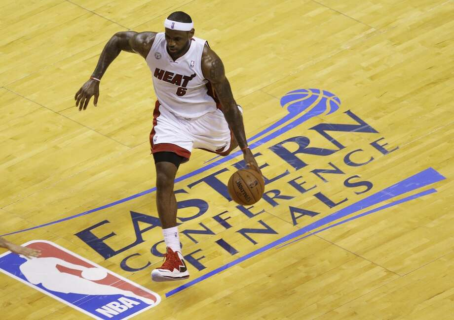 Miami Heat small forward LeBron James (6) dribbles the ball during the first half of Game 7 in their NBA basketball Eastern Conference finals playoff series against the Indiana Pacers, Monday, June 3, 2013 in Miami. (AP Photo/Wilfredo Lee)