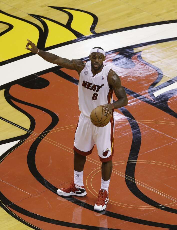 Miami Heat small forward LeBron James (6) directs the play during the first half of Game 7 in their NBA basketball Eastern Conference finals playoff series against the Indiana Pacers, Monday, June 3, 2013 in Miami. (AP Photo/Wilfredo Lee)