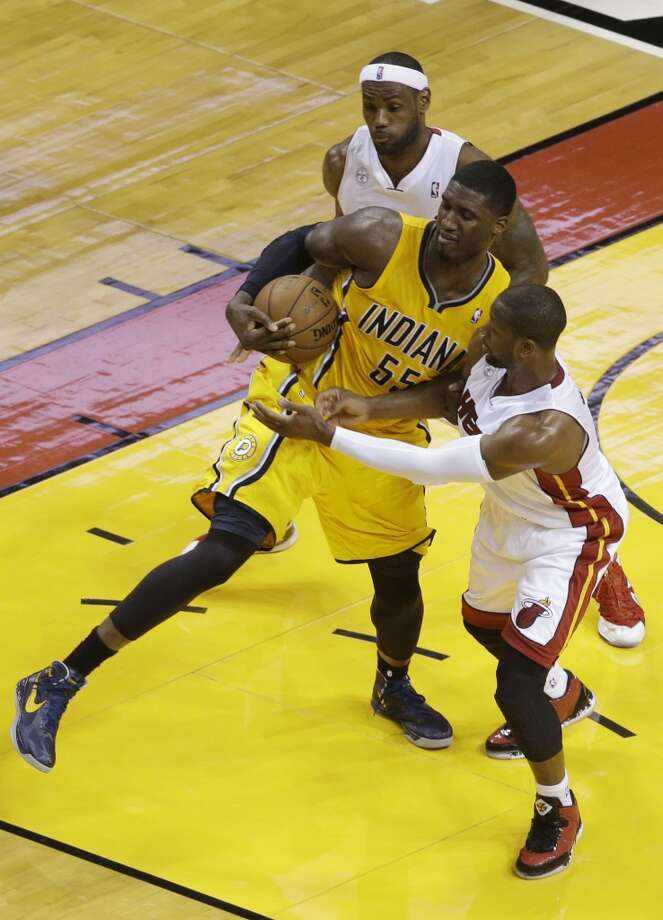 Indiana Pacers center Roy Hibbert (55) and Miami Heat shooting guard Dwyane Wade (3) fights over a loose ball as LeBron James watches during the first half of Game 7 in their NBA basketball Eastern Conference finals playoff series, Monday, June 3, 2013 in Miami. (AP Photo/Wilfredo Lee)