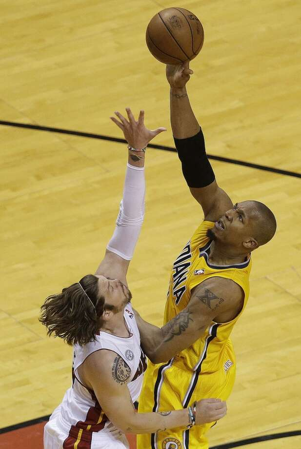 Indiana Pacers power forward David West (21) shoots over Miami Heat shooting guard Mike Miller (13) during the second half of Game 7 in their NBA basketball Eastern Conference finals playoff series, Monday, June 3, 2013 in Miami. (AP Photo/Wilfredo Lee)