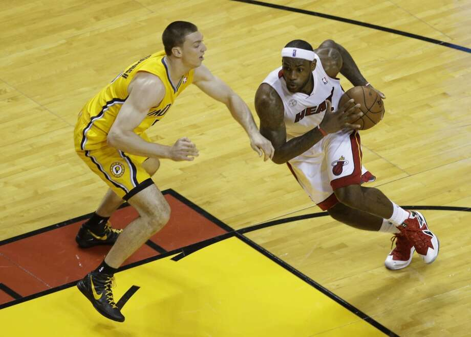 Miami Heat small forward LeBron James (6) dribbles the ball asIndiana Pacers power forward Tyler Hansbrough (50) defends during the first half of Game 7 in their NBA basketball Eastern Conference finals playoff series, Monday, June 3, 2013 in Miami. (AP Photo/Wilfredo Lee)