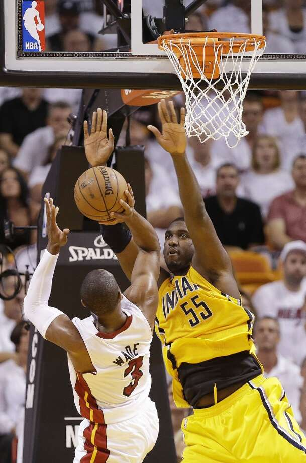 Miami Heat shooting guard Dwyane Wade (3) shoots under pressure from Indiana Pacers center Roy Hibbert (55) during the first half of Game 7 in their NBA basketball Eastern Conference finals playoff series, Monday, June 3, 2013 in Miami. (AP Photo/Lynne Sladky)